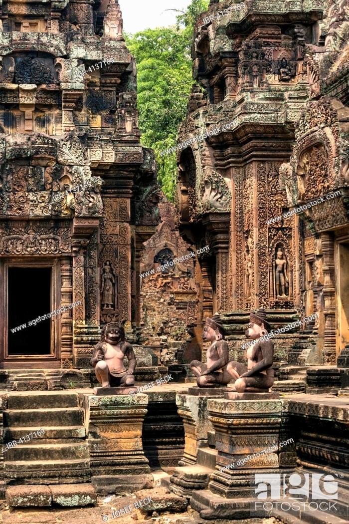 Stock Photo: Yaksha Guardian, guardian figures in front of the Mandapa, Khmer Hindu temple Banteay Srei, Angkor region, Siem Reap Province, Cambodia.