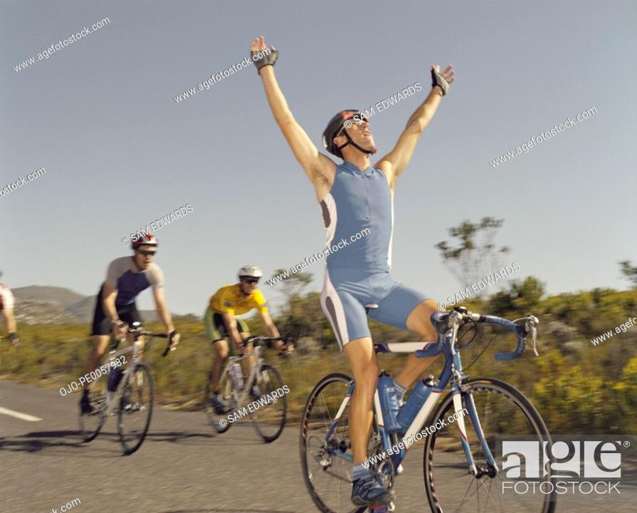 Stock Photo: A man winning a bike race.