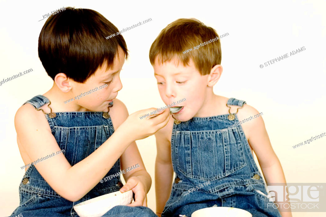Stock Photo: two boys eating.