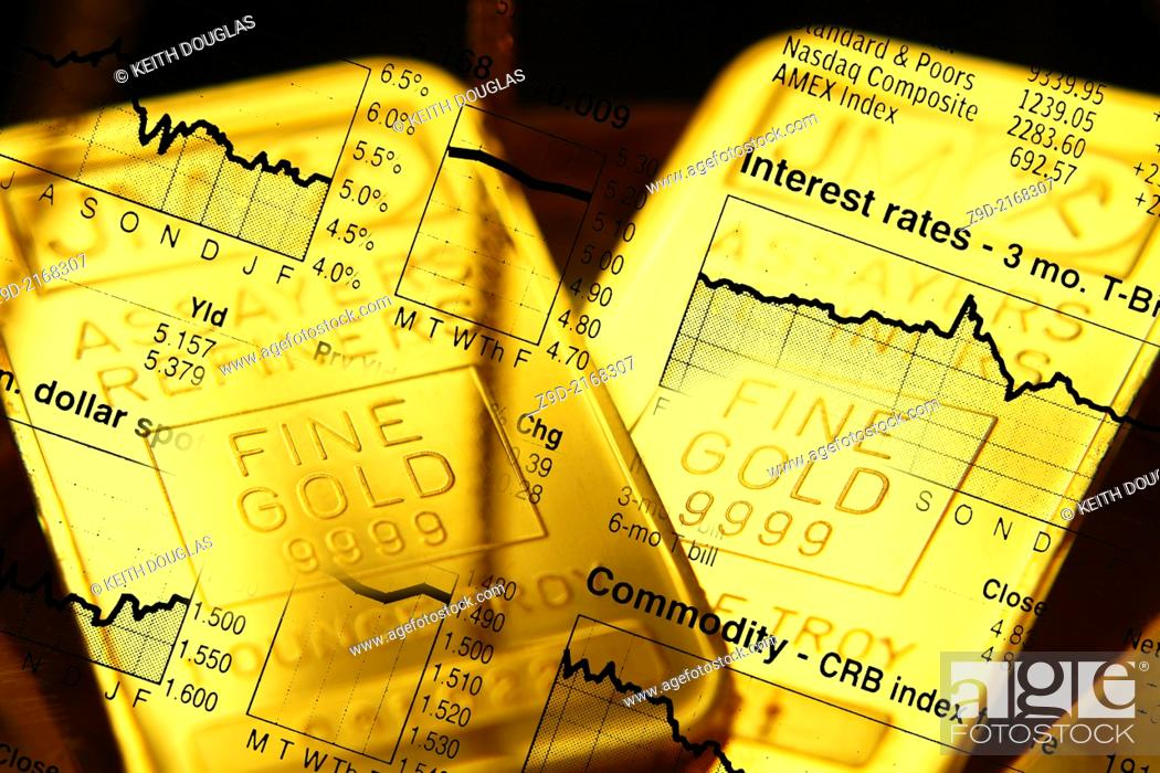 Stock Photo: Business concept with gold bars overlaid with stock market illustration.