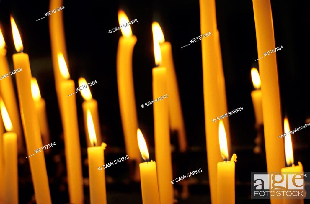 Stock Photo: Candles burning in the Auch Cathedral, Auch, France.