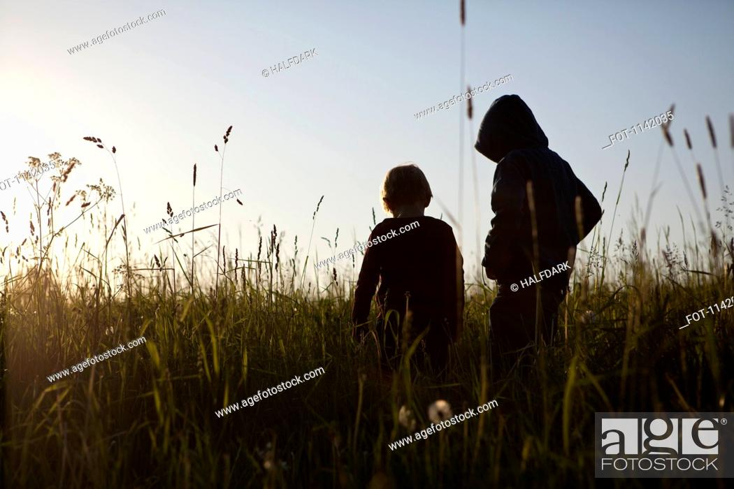 Stock Photo: Two boys standing in a field.