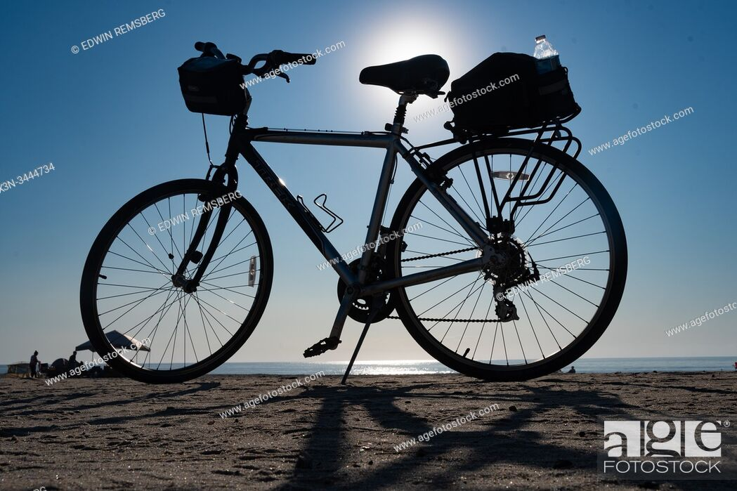 Stock Photo: A bike parked at the beach on a clear day, .