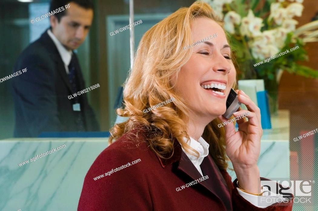 Stock Photo: Close-up of a mature woman talking on a mobile phone.