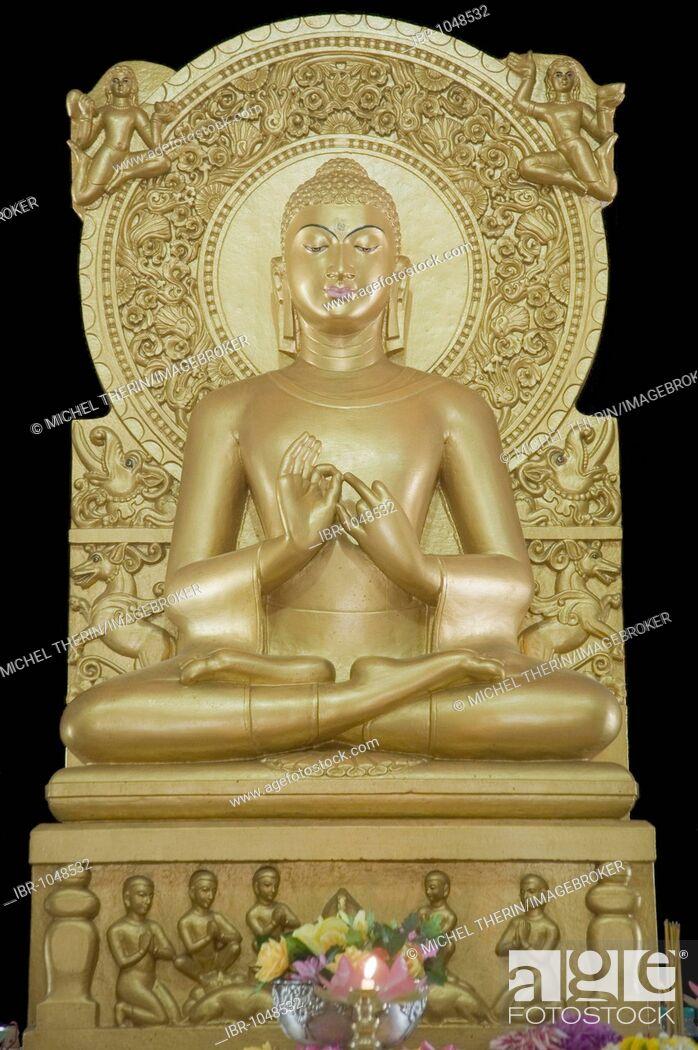 Stock Photo: Golden Buddha statue, Mulagandha Kuti Vihara Buddhist temple, Sarnath, Uttar Pradesh, India, South Asia.