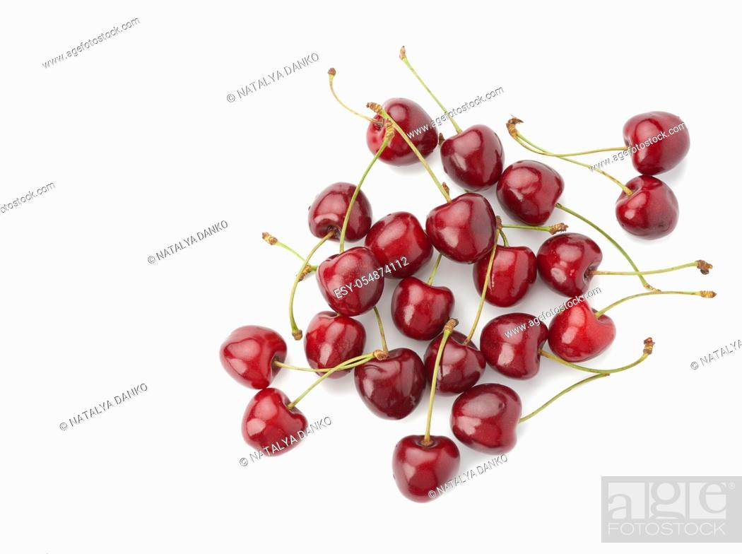 Stock Photo: whole ripe red juicy sweet cherries isolated on a white background, top view, flat lay.