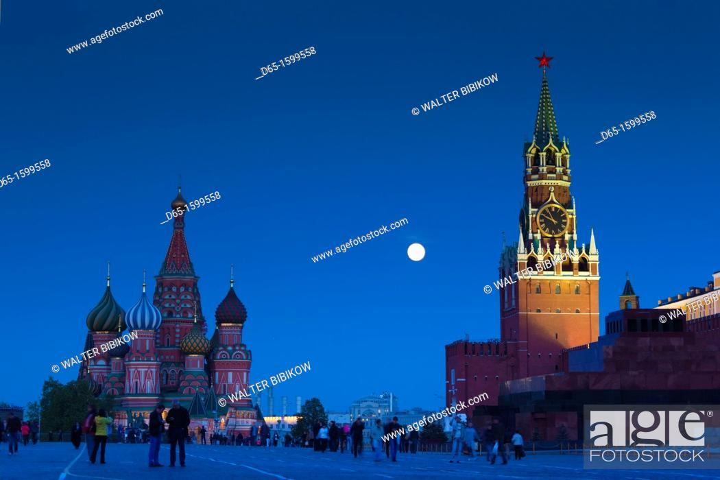 Stock Photo: Russia, Moscow Oblast, Moscow, Red Square, Kremlin, Saint Basils Cathedral and Kremlin Spasskaya Tower with moonrise.