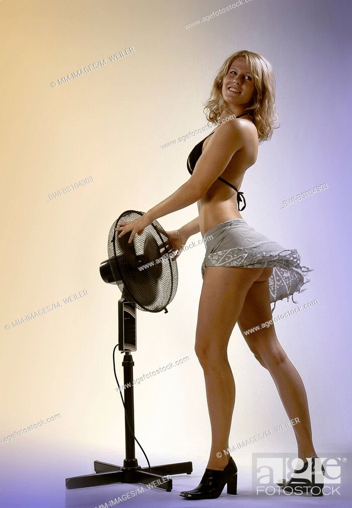 Stock Photo: Young attractive woman with ventilator.