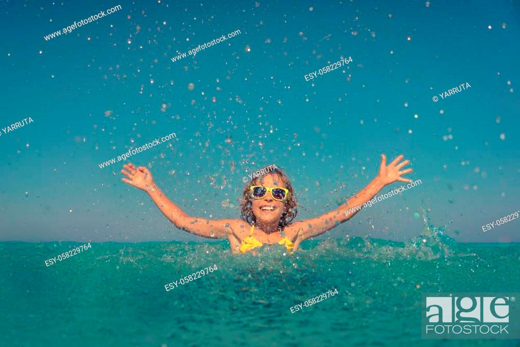 Stock Photo: Happy child playing in the sea. Kid having fun on summer vacation. Healthy active lifestyle concept.