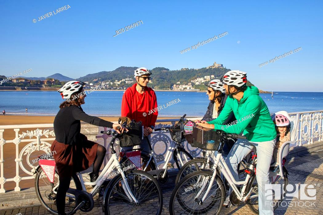 Stock Photo: Group of tourists and guide making a bicycle tour through the city, La Concha Bay, Donostia, San Sebastian, Gipuzkoa, Basque Country, Spain, Europe.