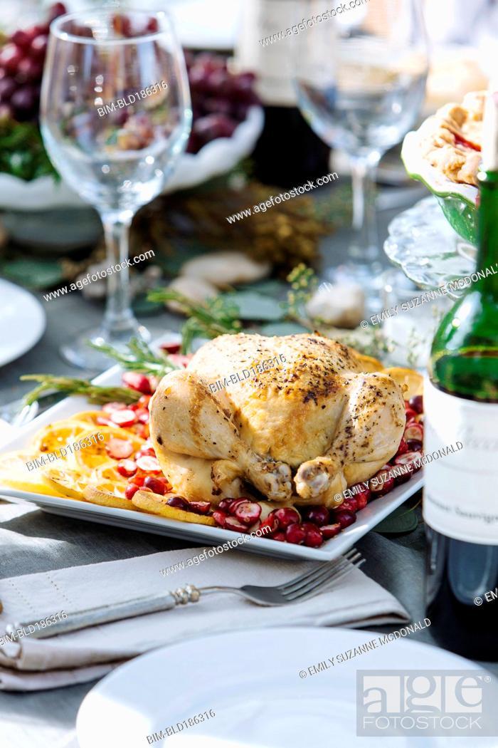 Stock Photo: Roast chicken dinner on table.