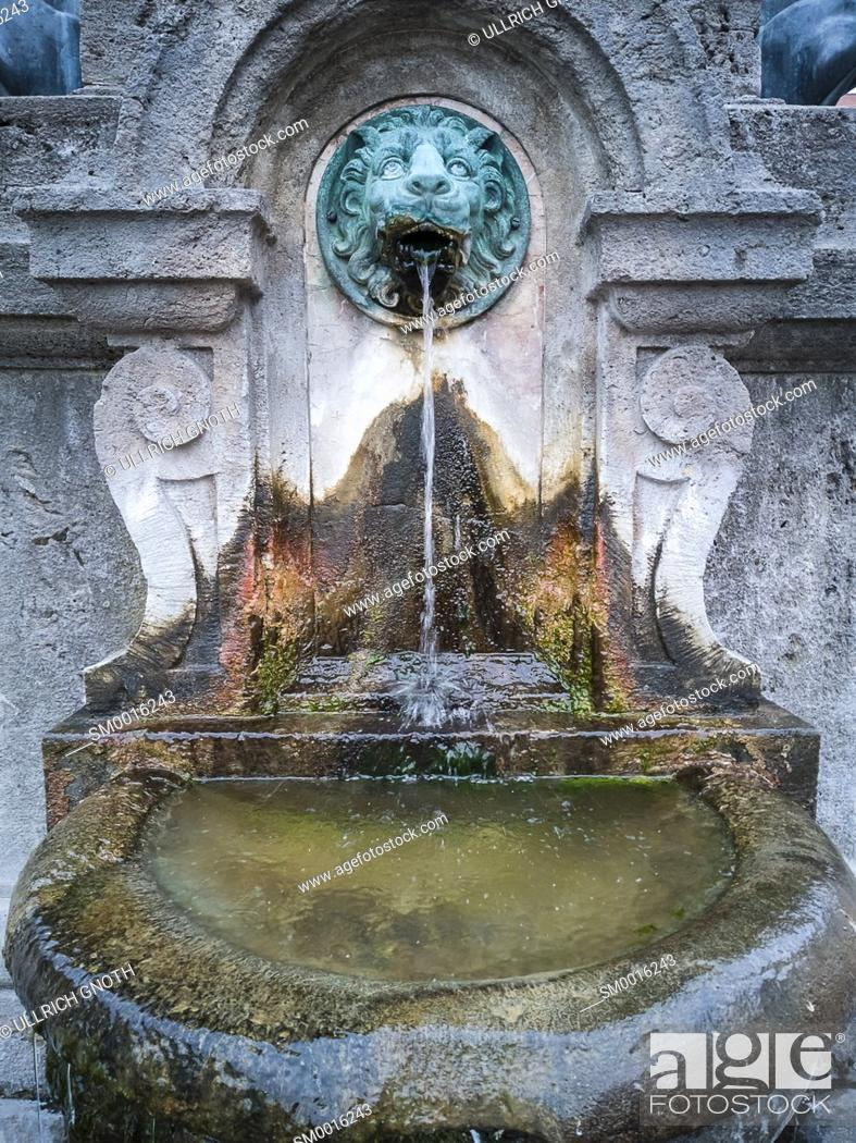 Stock Photo: Fountain with lion face at the war memorial in Freising, Bavaria, Germany.