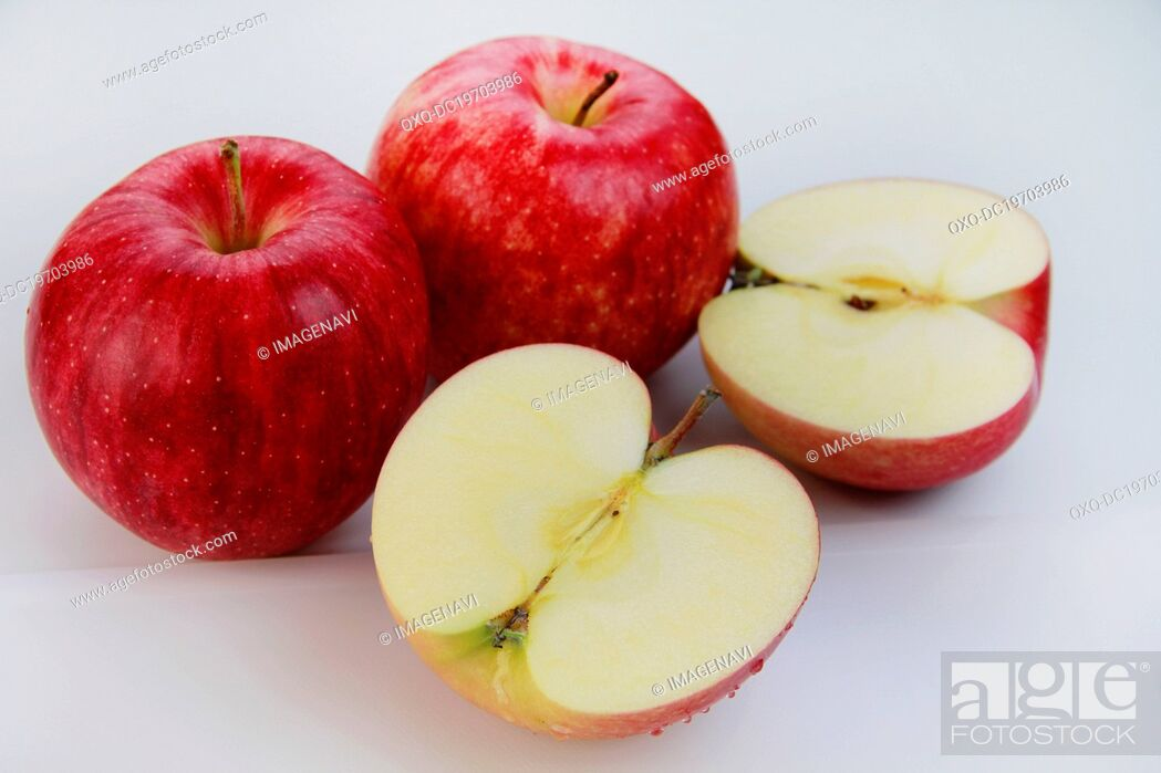 Stock Photo: Whole and halved red apples.