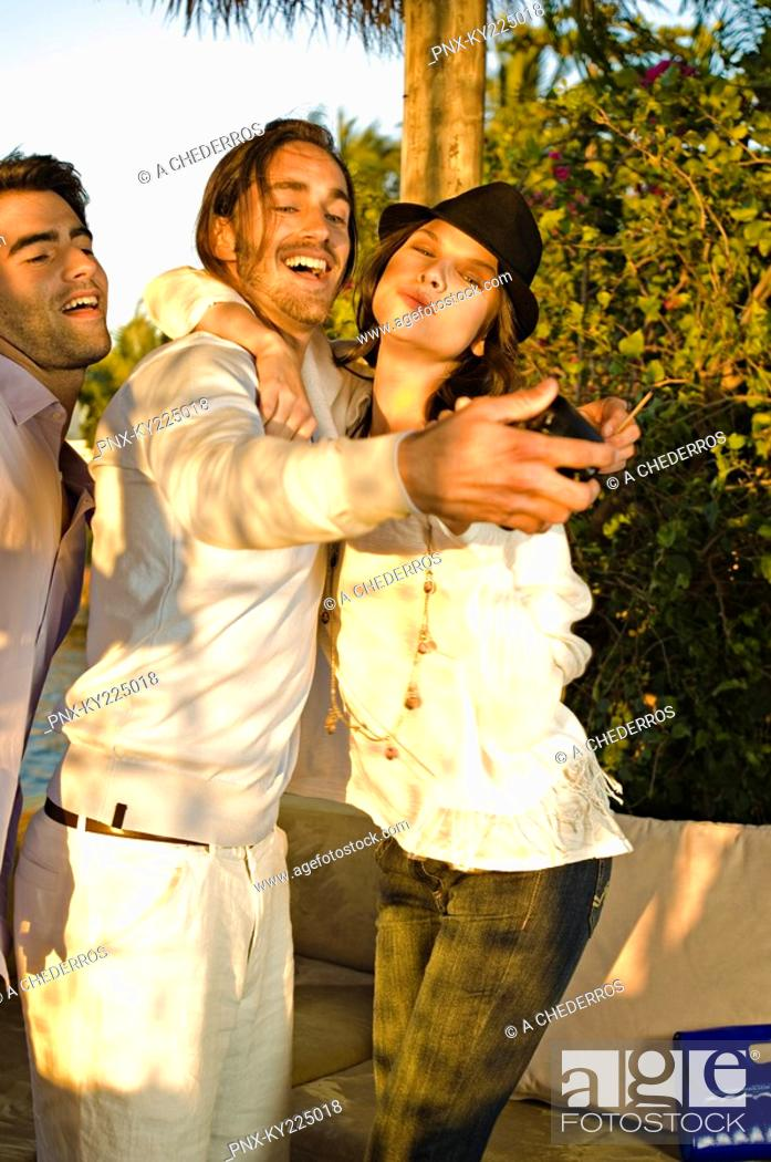 Stock Photo: Three friends taking a picture of themselves.