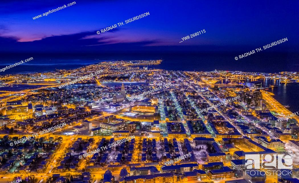 Stock Photo: Top view of roads, homes, buildings at twilight, wintertime, Reykjavik, Iceland. This image is shot with a drone.