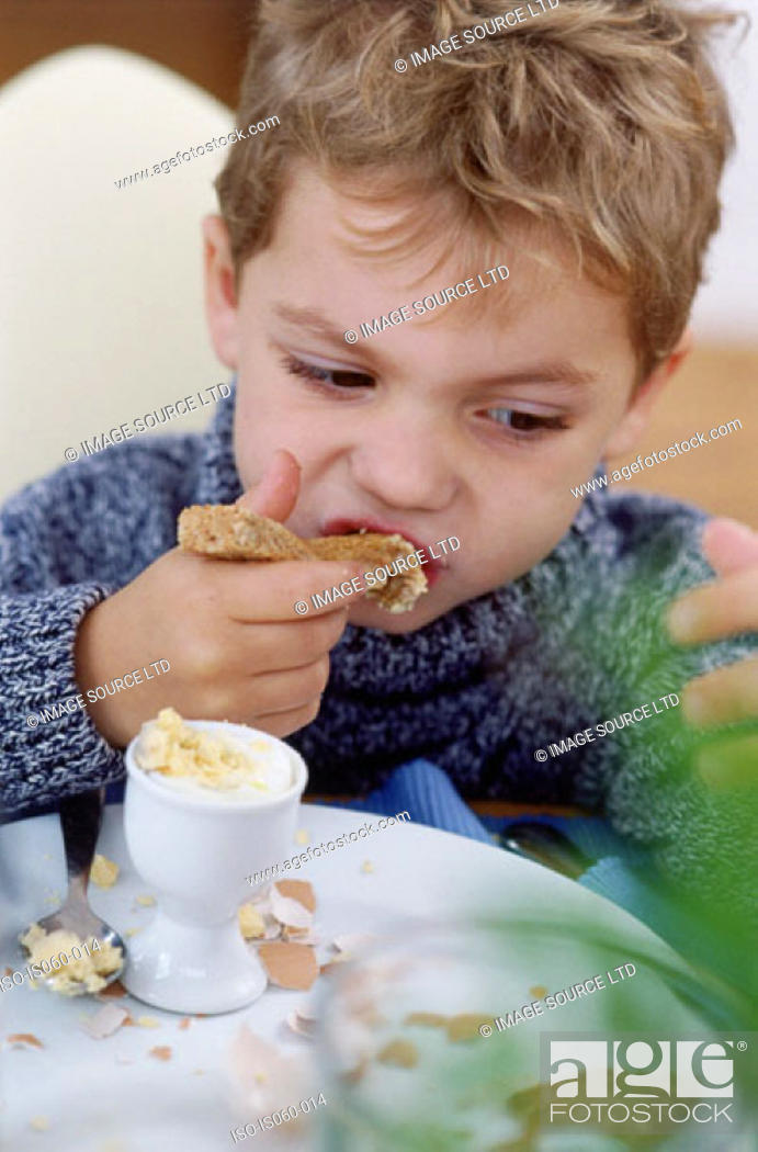 Stock Photo: Boy eating breakfast.