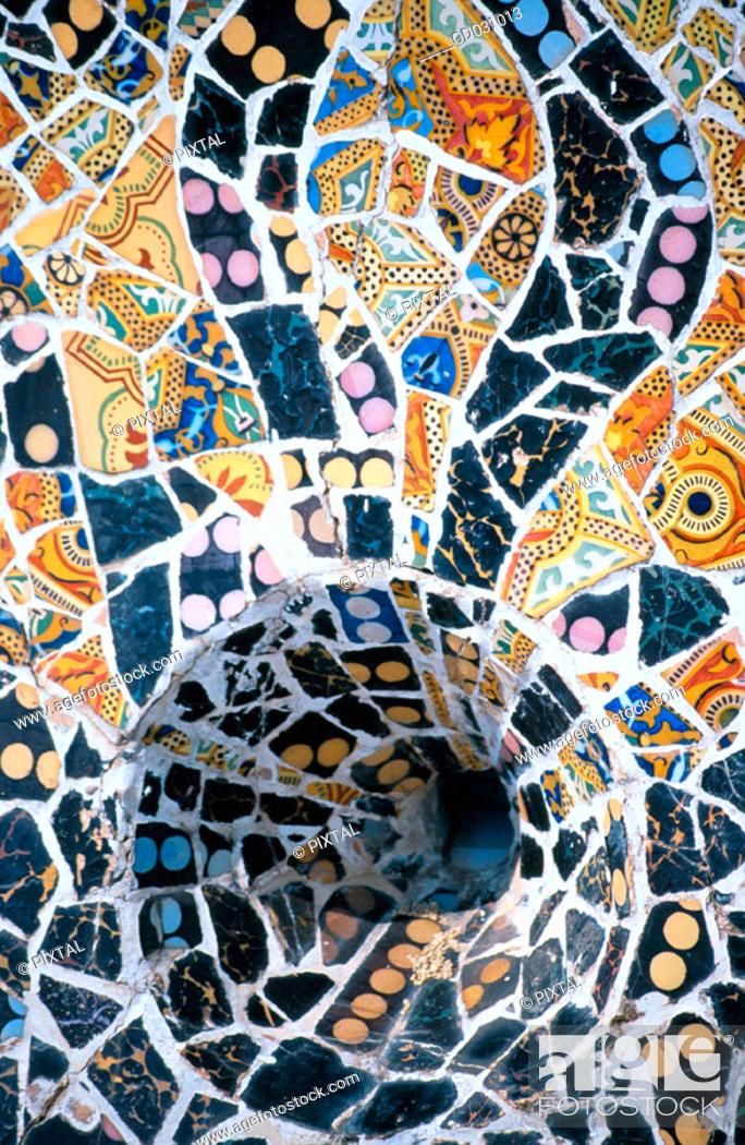 Stock Photo: Detail of 'trencadís' (lit. 'breakage') -typical handmade work by Gaudí with pieces of ceramics- at Güell Park (Gaudí, 1900-1914). Barcelona. Spain.