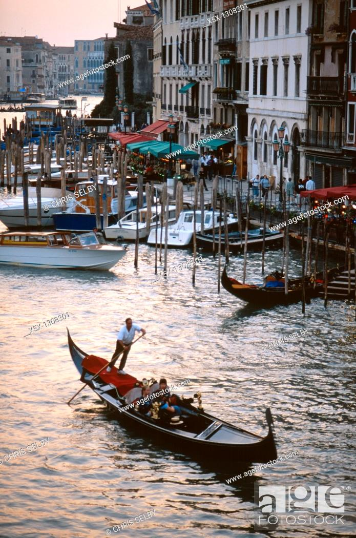 Stock Photo: Gondola on the Grand Canal at sunset in Venice, Italy.