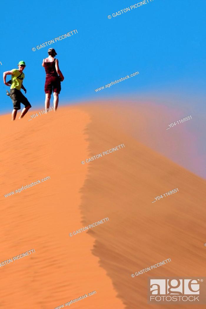 Stock Photo: People in the Dune 45 in Ses Riem, Namib-Naukluft National Park, Namib desert, Namibia.