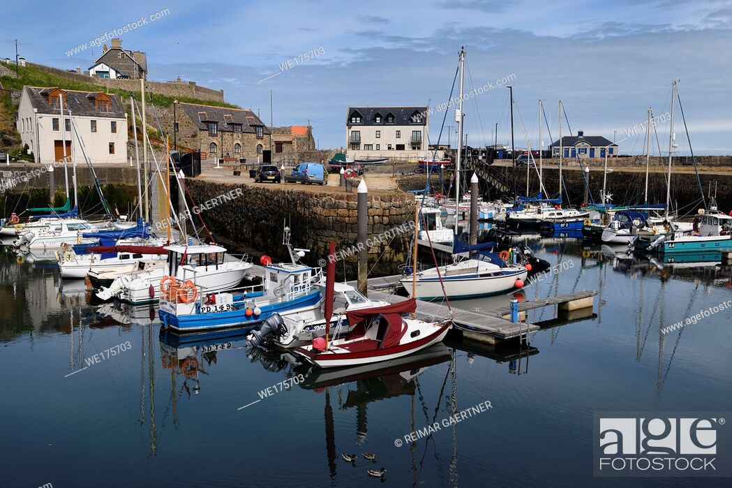 Stock Photo: Morning at Banff Harbour marina with docked boats and sailboats on Banff Bay Moray Firth Aberdeenshire Scotland UK.