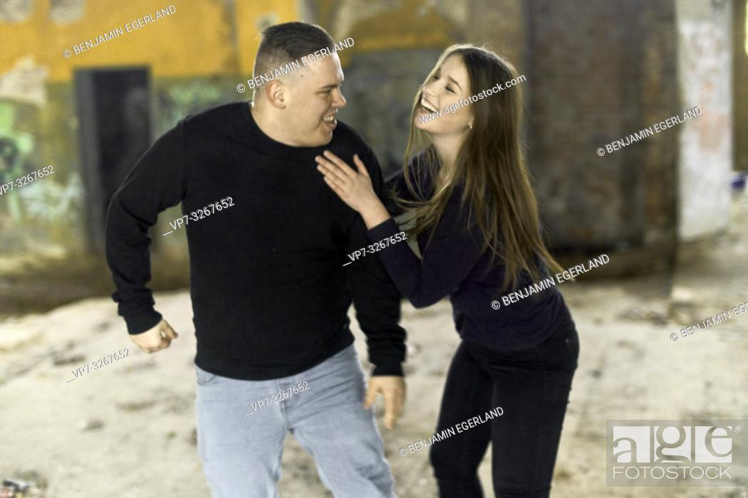 Stock Photo: playful couple teasing in house ruin, in Cottbus, Brandenburg, Germany.