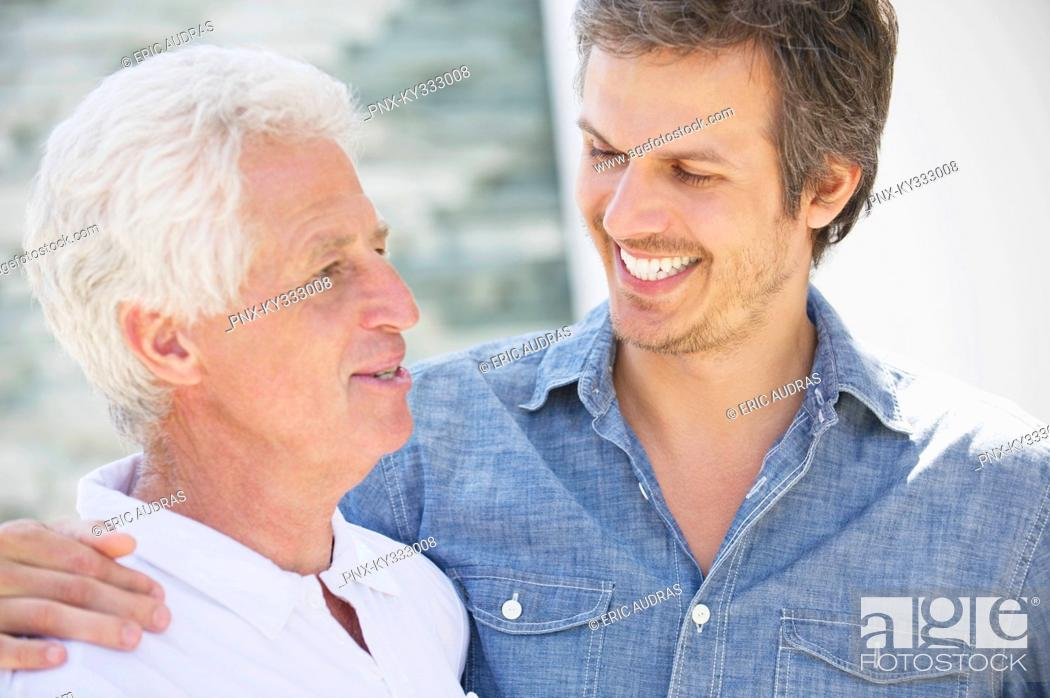 Stock Photo: Close-up of a mid adult man smiling with his father.