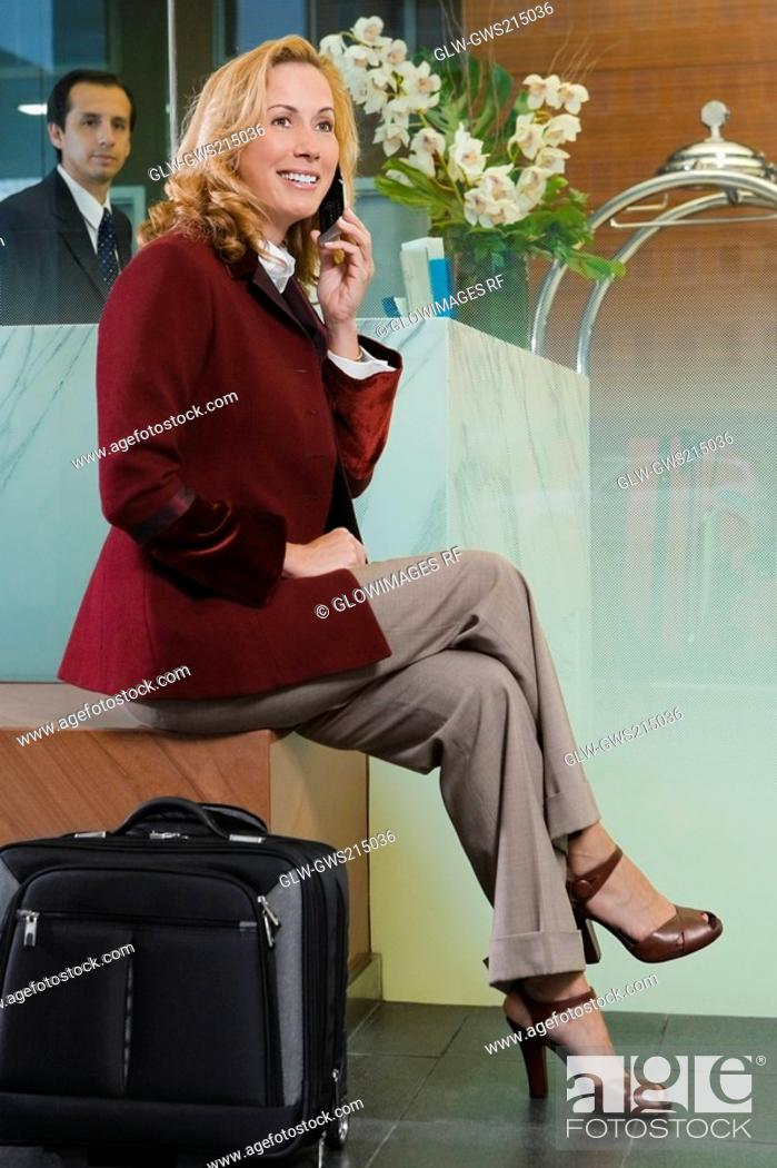 Stock Photo: Mature woman talking on a mobile phone.