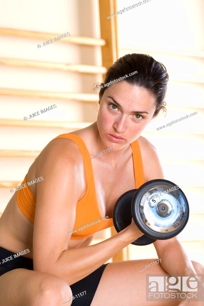 Stock Photo: Woman using dumbbell, portrait, close-up.