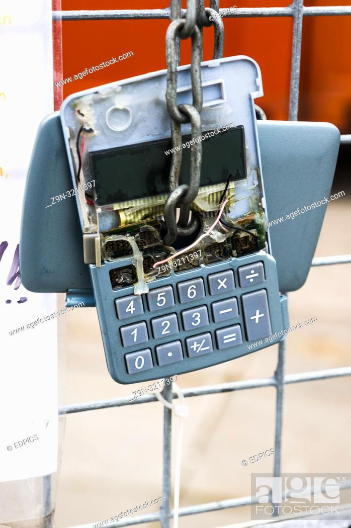 Imagen: broken calculator hanging on a fence, stuttgart, baden-wuerttemberg, germany.