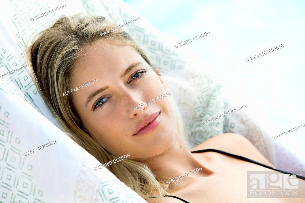 Stock Photo: Woman sunbathing, portrait.