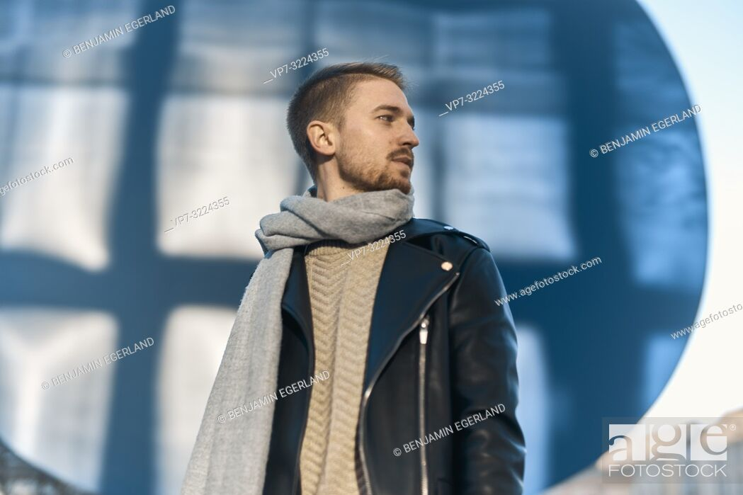 Stock Photo: fashionable man wearing winter clothes, scarf, looking to side, in Munich, Germany.