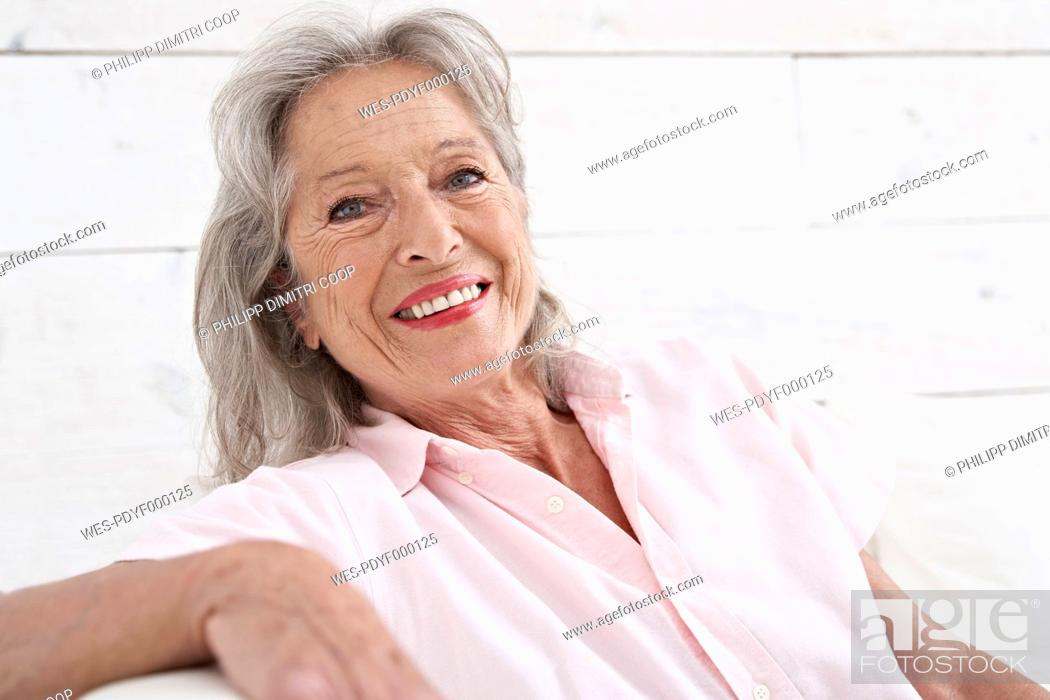Stock Photo: Spain, Senior woman smiling, portrait.