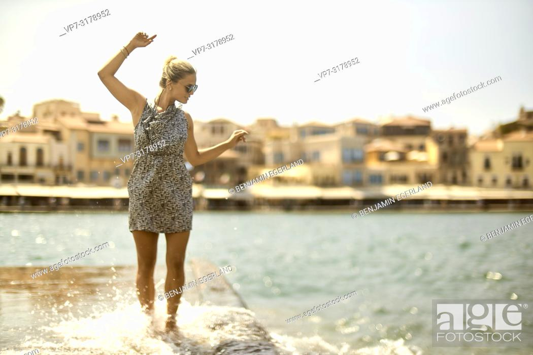 Stock Photo: woman at harbour of Chania, Crete, Greece.
