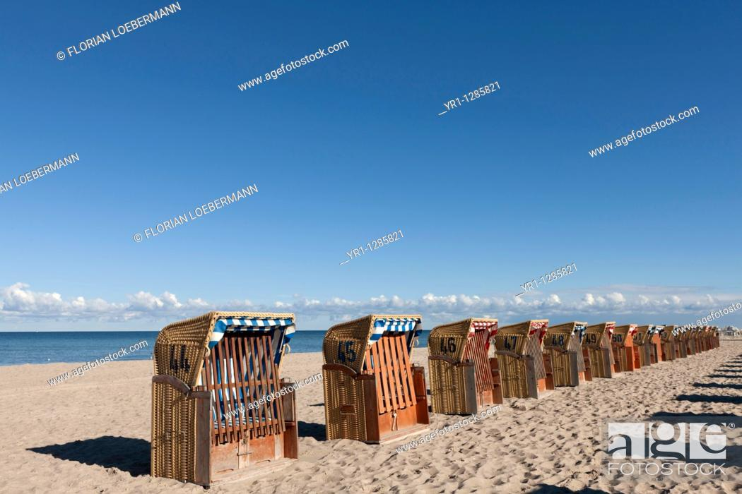 Stock Photo: Group of beach chairs on the beach. Shot near the Hanseatic city of Wismar, Germany.