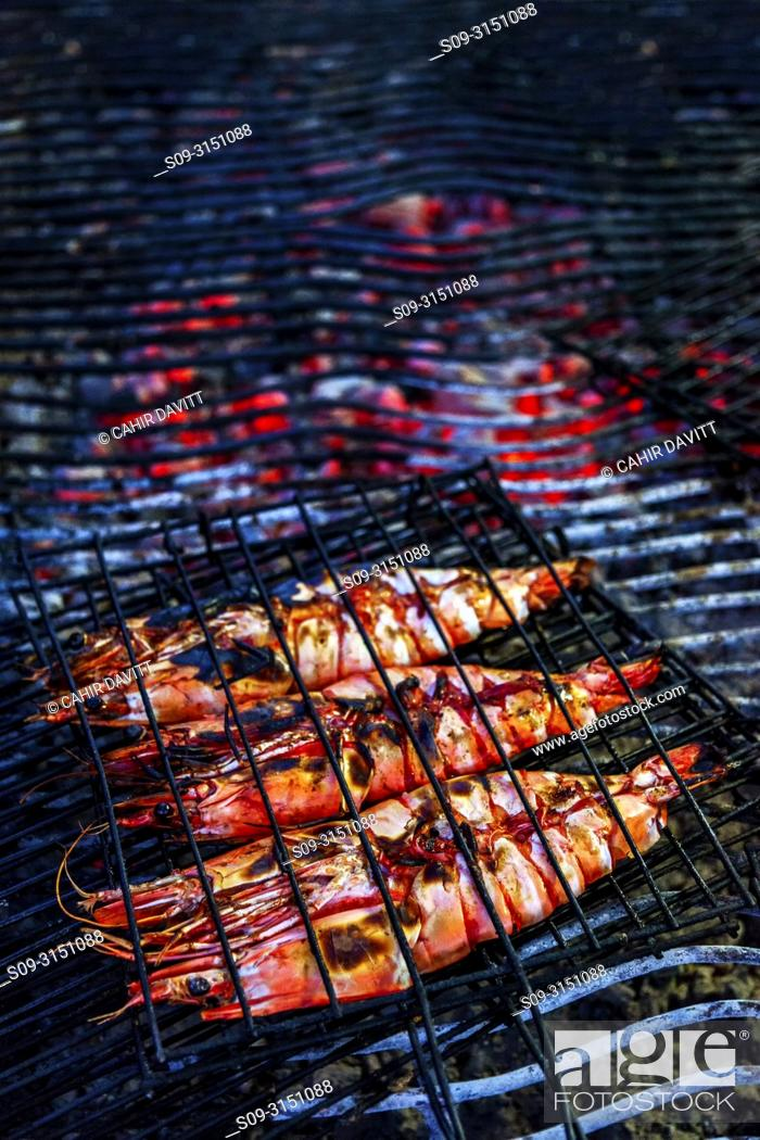 Stock Photo: Grilled tiger prawns on the barbecue, Ferrgudo, Portimao, Faro, Portugal.