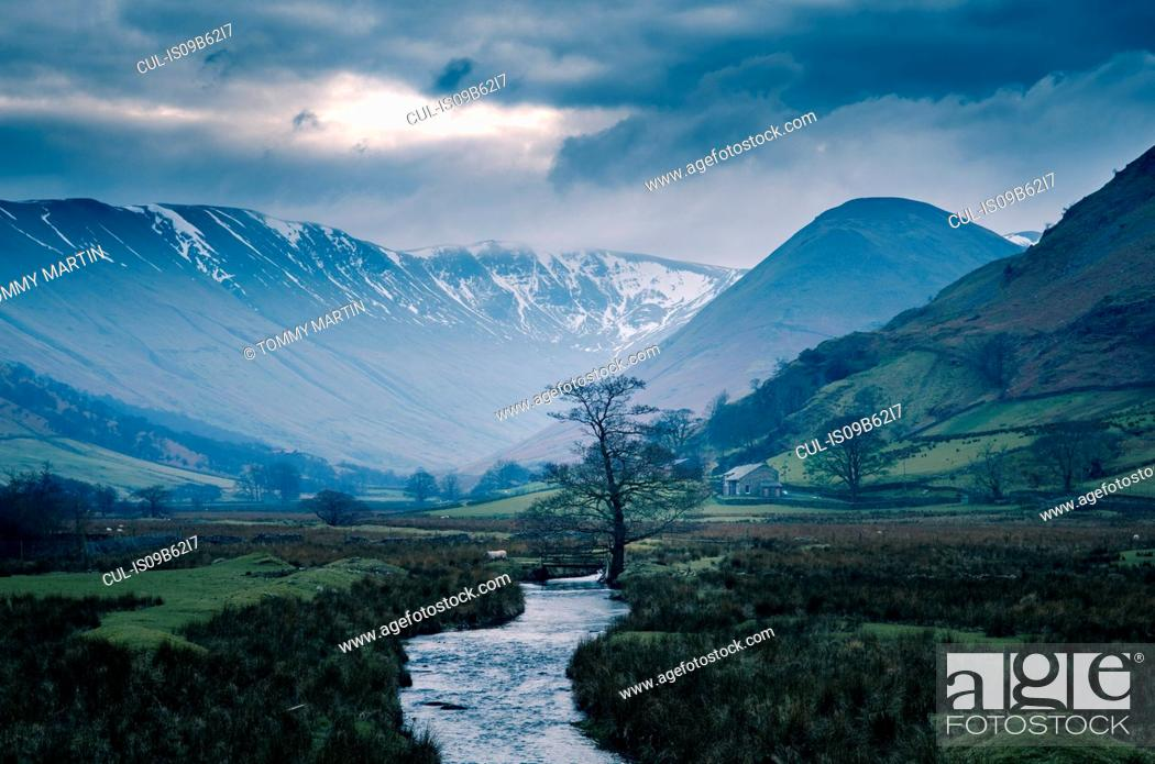 Stock Photo: Storm clouds over snow capped mountains at Martindale, The Lake District, UK.