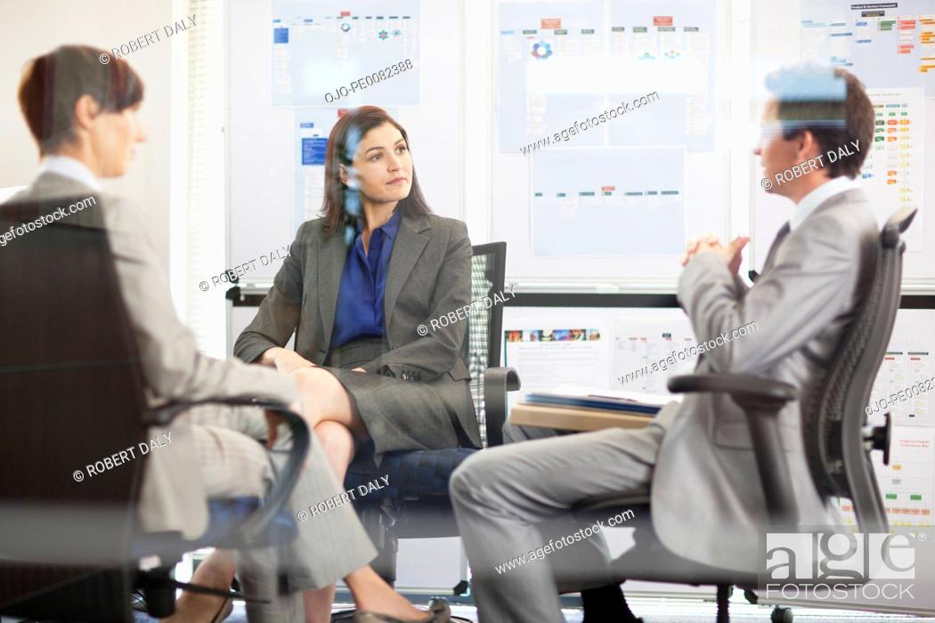 Stock Photo: Business people meeting in conference room.