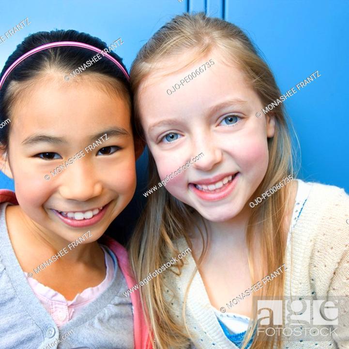 Stock Photo: Girls smiling.