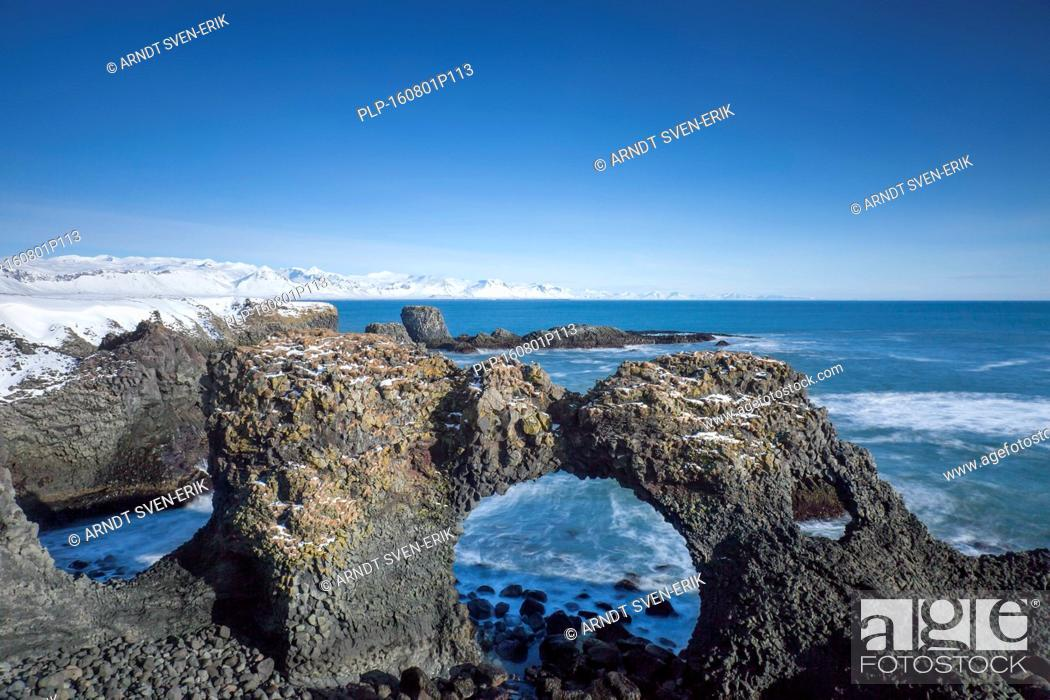 Stock Photo: Gatklettur - Arch Rock - cliff with natural arch near Arnarstapi, Snaefellsnes, Iceland.