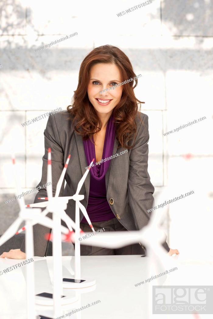 Stock Photo: Germany, Leipzig, Businesswoman with wind power model.