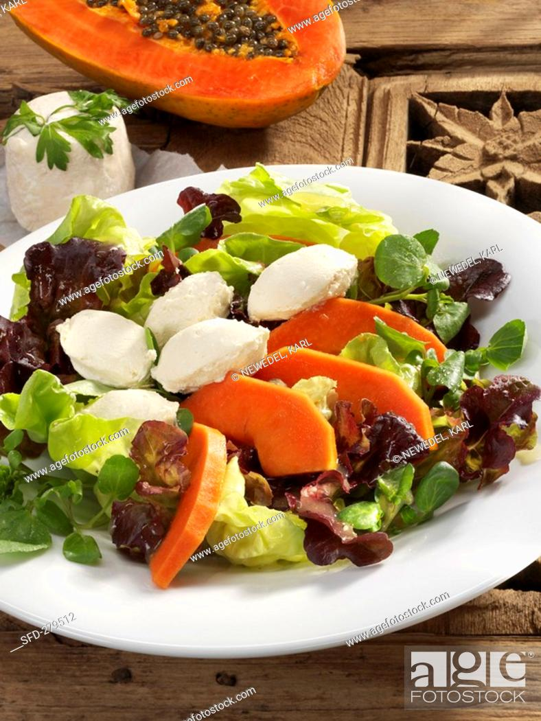 Stock Photo: Salad leaves with papaya and goat's cheese.