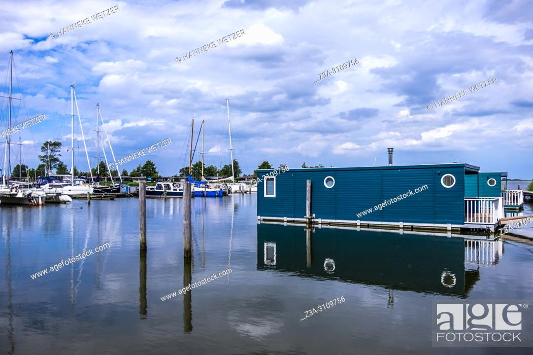 Stock Photo: Houseboat in the port of Lauwersoog, Groningen, The Netherlands, Europe.