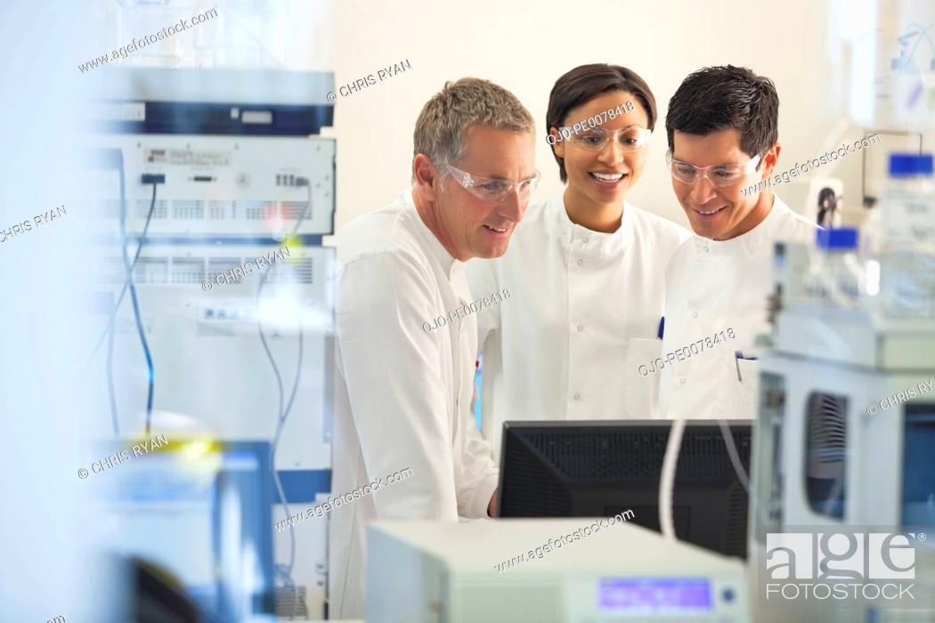 Stock Photo: Scientists using equipment in lab.