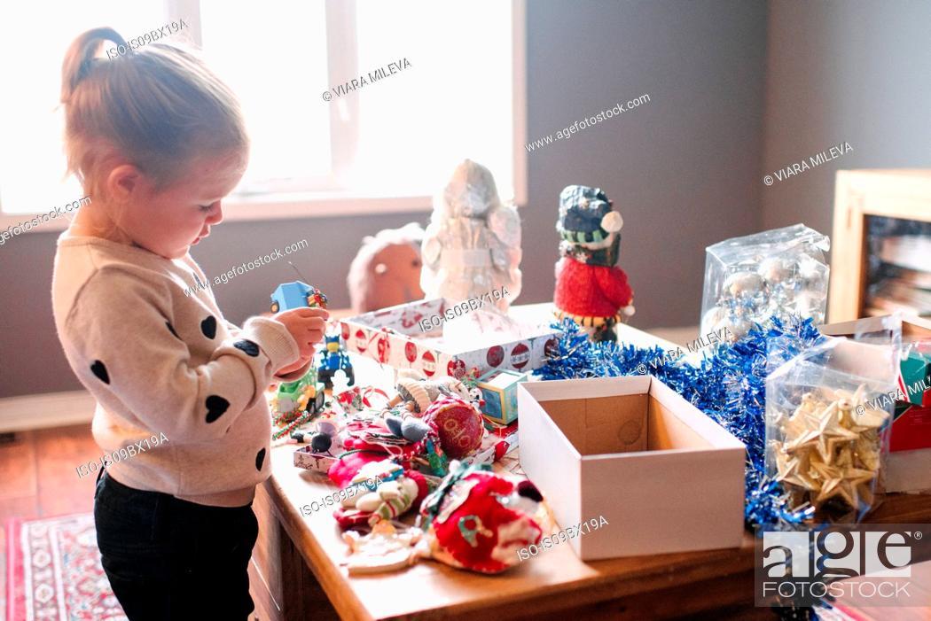Stock Photo: Toddler girl preparing for Christmas.