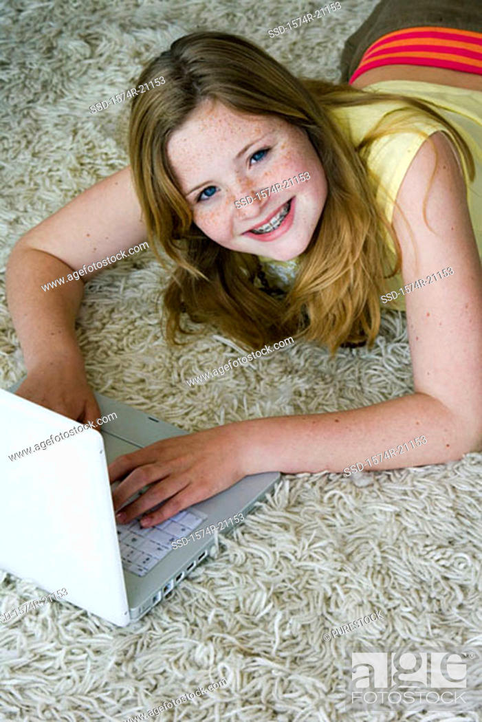 Stock Photo: High angle view of a girl using a laptop.