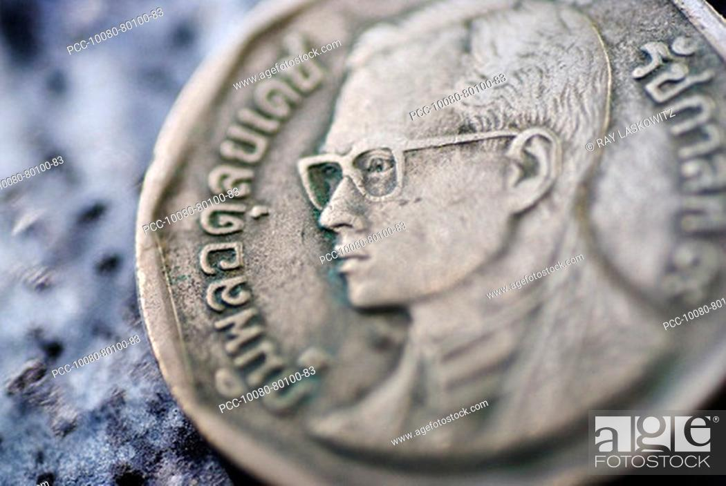 Stock Photo: Close-up detail of an asian coin, Thai baht.