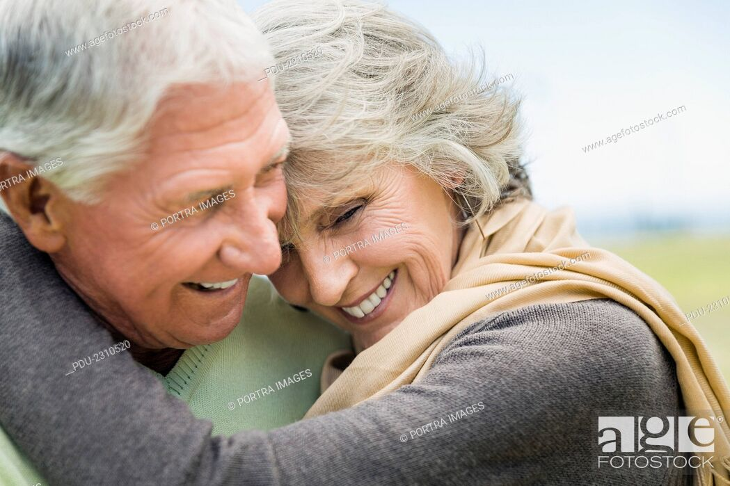 Stock Photo: Close-up of happy senior couple embracing in park.