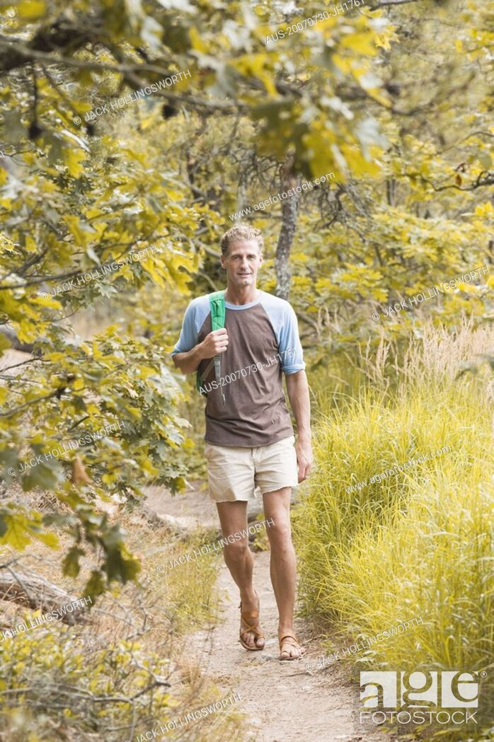 Stock Photo: Mature man hiking in a forest.