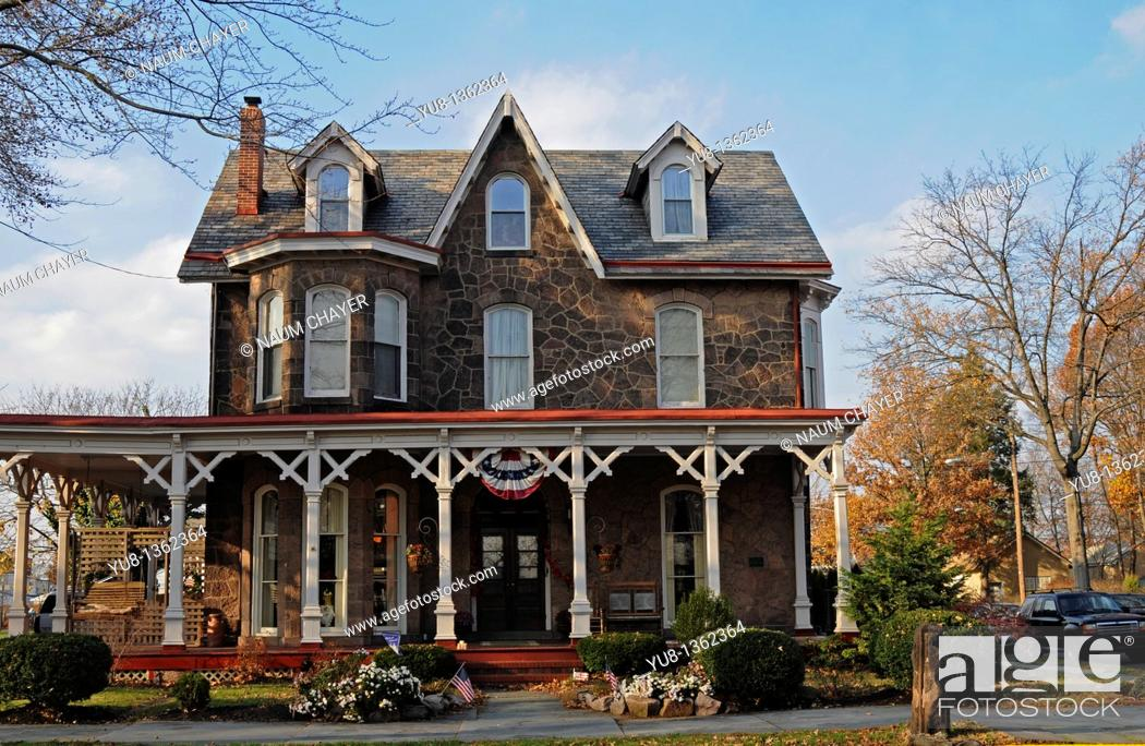 Stock Photo: Old building in Victorian style with big wooden terrace, Bristol, Pennsylvania, USA.