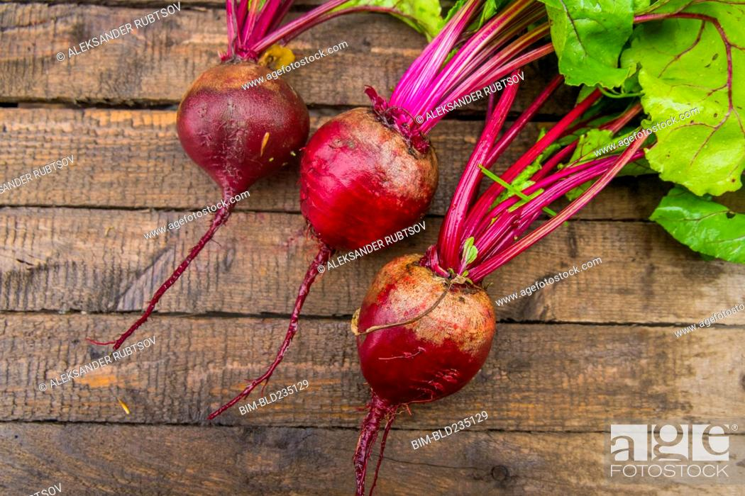 Stock Photo: Fresh beets on wooden table.